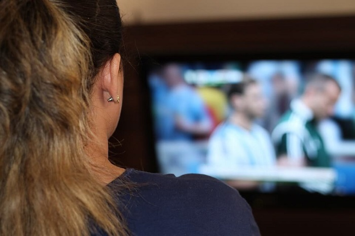 woman watching sports on tv