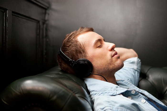 man listening to music in his office
