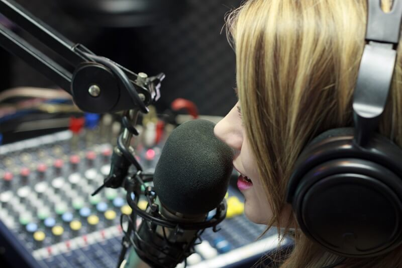 female DJ on air on the radio