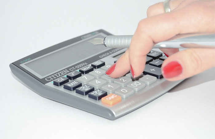 Person using gray calculator