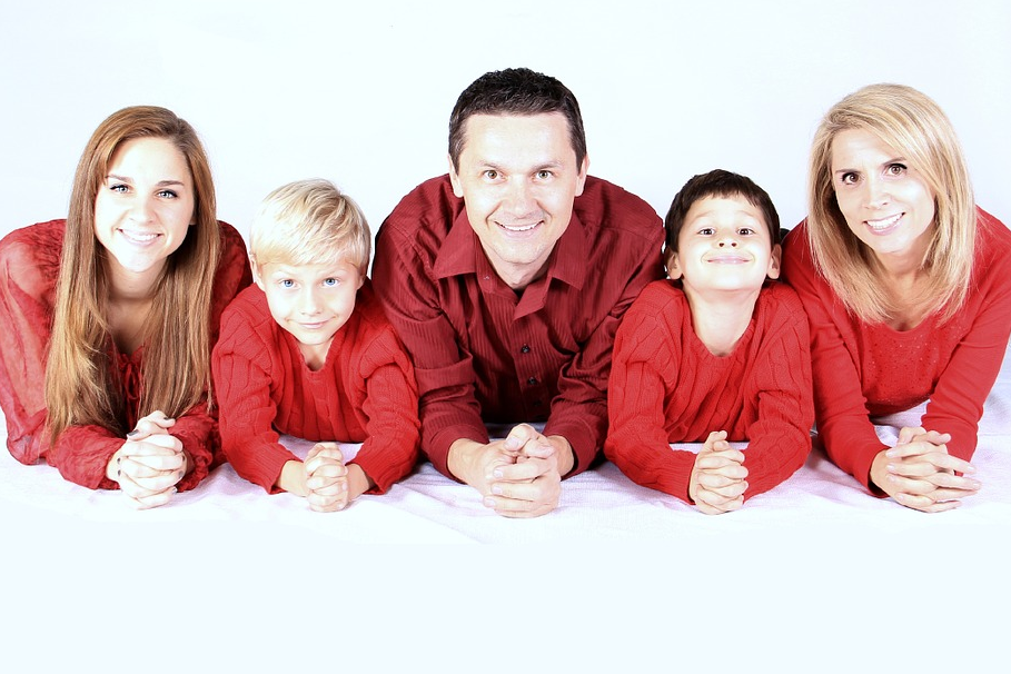 whole family wearing red clothes against white background